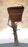 #07 Ne'erspiller the Barrel-Bucket Carrier, a container built from their own limbs (unmasked)